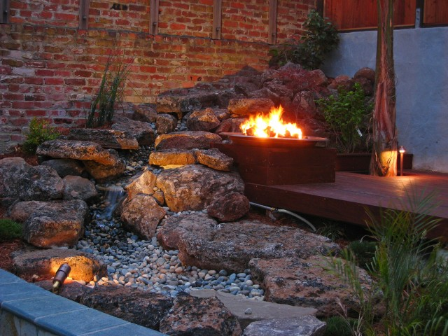 outdoor waterfall construction with fire pit